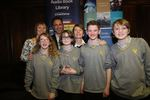 The school that came third, Comberton Village School, holding the trophy (presented to the Librarian) by Softlink